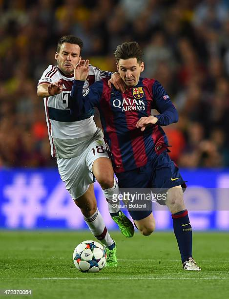 Lionel Messi of Barcelona and Juan Bernat of Bayern Muenchen battle for the ball during the UEFA Champions League Semi Final first leg match between...