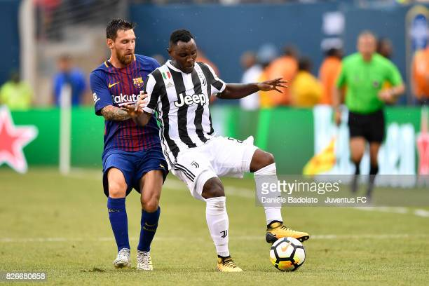 Lionel Messi of Barcelona and Kwadwo Asamoah of Juventus in action during the International Champions Cup match between Juventus and Barcelona at...