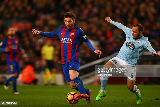 Lionel Messi of Barcelona battles for the ball with Marcelo Diaz of Celta Vigo during the La Liga match between FC Barcelona and RC Celta de Vigo at...