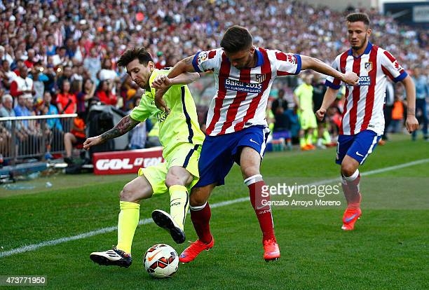 Lionel Messi of Barcelona battles with Guilherme Siqueira of Atletico Madrid during the La Liga match between Club Atletico de Madrid and FC...