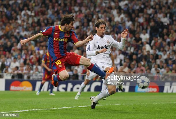 Lionel Messi of Barcelona beat Sergio Ramos of Real Madrid to score the opening goal during the UEFA Champions League Semi Final first leg match...