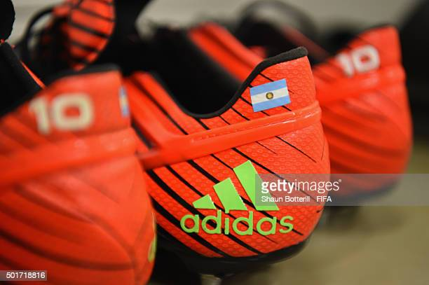 Lionel Messi of Barcelona boots in the dressing room before the FIFA Club World Cup Semi Final match between Barcelona and Guangzhou Evergrande FC at...