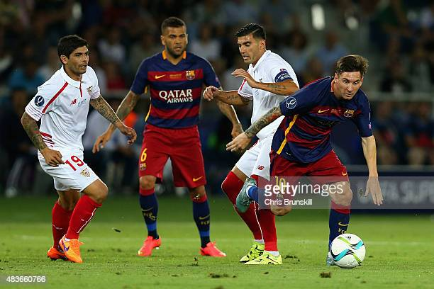 Lionel Messi of Barcelona breaks away from Jose Antonio Reyes of Sevilla during the UEFA Super Cup between Barcelona and Sevilla FC at Dinamo Arena...
