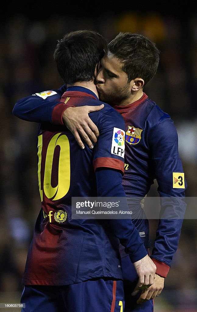 <a gi-track='captionPersonalityLinkClicked' href=/galleries/search?phrase=Lionel+Messi&family=editorial&specificpeople=453305 ng-click='$event.stopPropagation()'>Lionel Messi</a> of Barcelona celebrate scoring with his teammate <a gi-track='captionPersonalityLinkClicked' href=/galleries/search?phrase=Jordi+Alba&family=editorial&specificpeople=5437949 ng-click='$event.stopPropagation()'>Jordi Alba</a> during the La Liga match between Valencia and Barcelona Estadio Mestalla on February 3, 2013 in Valencia, Spain.