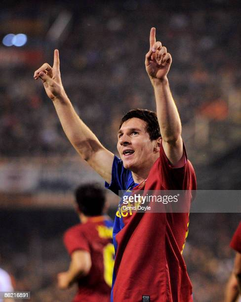 Lionel Messi of Barcelona celebrates after scoring Barcelona's first goal during the La Liga match between Valencia and Barcelona at the Mestalla...