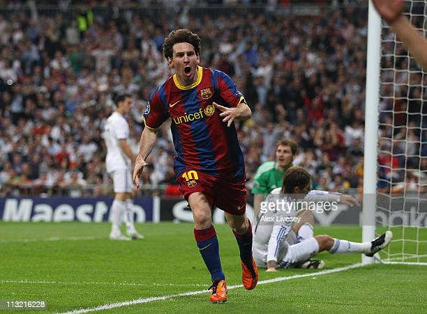 Lionel Messi of Barcelona celebrates after scoring his first goal during the UEFA Champions League Semi Final first leg match between Real Madrid and...