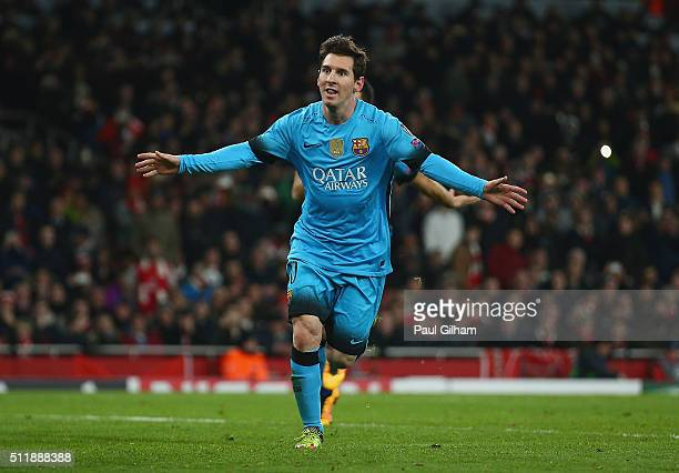 Lionel Messi of Barcelona celebrates after scoring his second goal during the UEFA Champions League round of 16 first leg match between Arsenal and...