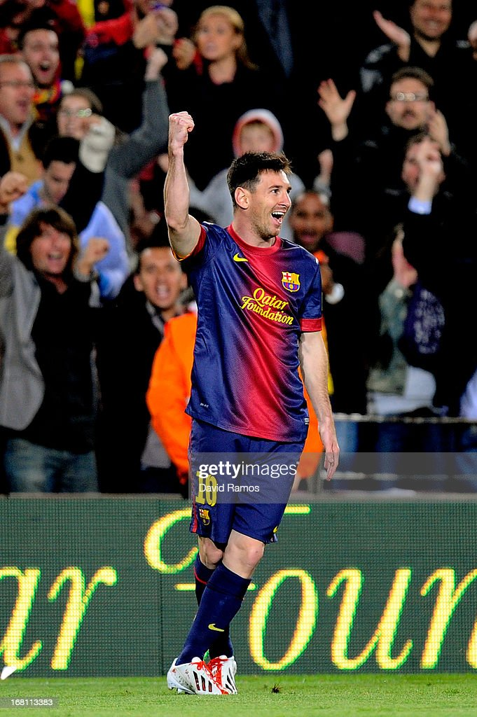Lionel Messi of Barcelona celebrates after scoring his team's third goal from a free kick during the La Liga match between FC Barcelona and Real...