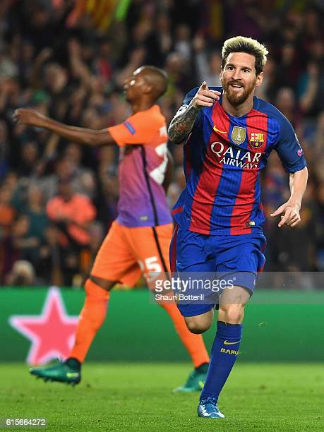 Lionel Messi of Barcelona celebrates after scoring his third and his team's third goal of the game during the UEFA Champions League group C match...