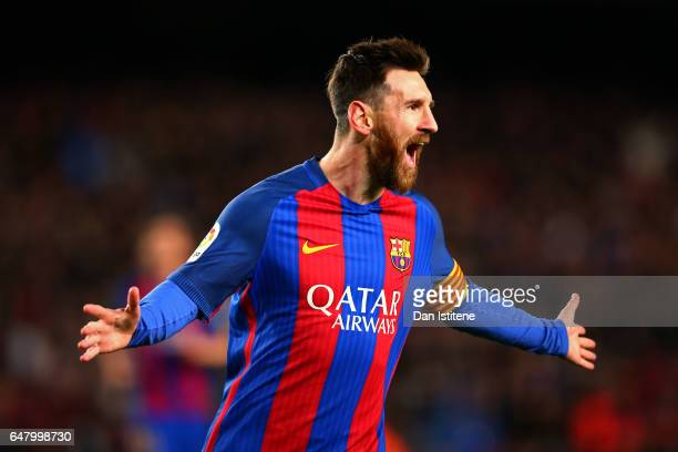 Lionel Messi of Barcelona celebrates after scoring the opening goal during the La Liga match between FC Barcelona and RC Celta de Vigo at the Camp...