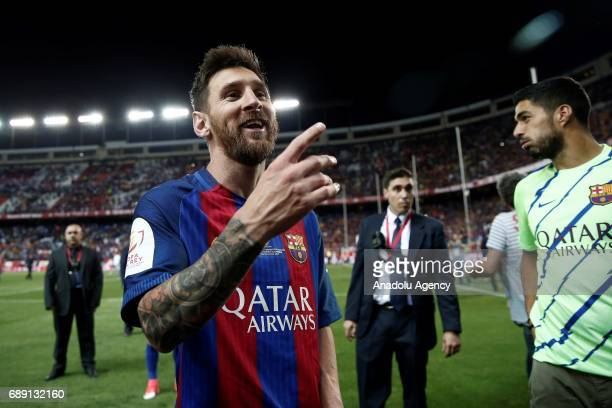 Lionel Messi of Barcelona celebrates after the Copa Del Rey Final between FC Barcelona and Deportivo Alaves at Vicente Calderon Stadium on May 27...