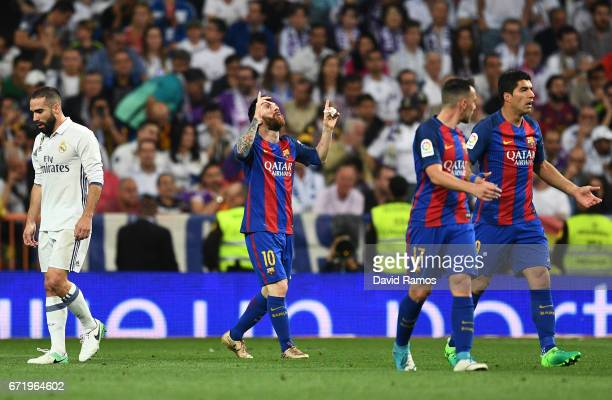 Lionel Messi of Barcelona celebrates as he scores their first and equalising goal with team mates during the La Liga match between Real Madrid CF and...