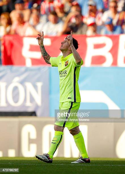 Lionel Messi of Barcelona celebrates as he scores their first goal during the La Liga match between Club Atletico de Madrid and FC Barcelona at...