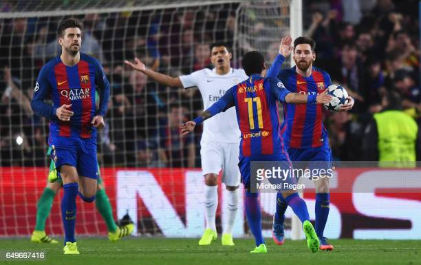 Lionel Messi of Barcelona celebrates as he scores their third goal from a penalty with Neymar during the UEFA Champions League Round of 16 second leg...