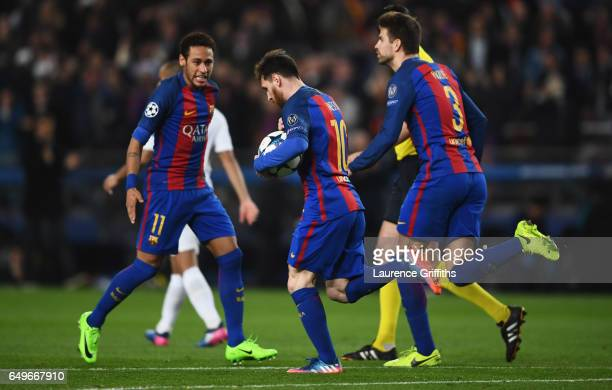 Lionel Messi of Barcelona celebrates as he scores their third goal from a penalty with Neymar and Gerard Pique during the UEFA Champions League Round...
