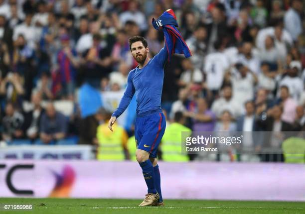Lionel Messi of Barcelona celebrates as he scores their third goal during the La Liga match between Real Madrid CF and FC Barcelona at Estadio...