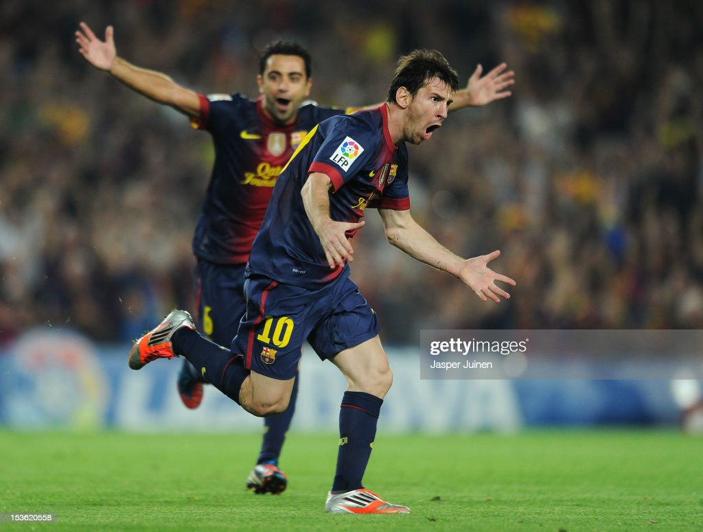 <a gi-track='captionPersonalityLinkClicked' href=/galleries/search?phrase=Lionel+Messi&family=editorial&specificpeople=453305 ng-click='$event.stopPropagation()'>Lionel Messi</a> (R) of Barcelona celebrates scoring beside his teammate Jordi Alba during the la Liga match between FC Barcelona and Real Madrid at the Camp Nou stadium on October 7, 2012 in Barcelona, Spain.