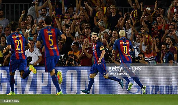 Lionel Messi of Barcelona celebrates scoring his sides first goal with Neymar of Barcelona during the UEFA Champions League Group C match between FC...