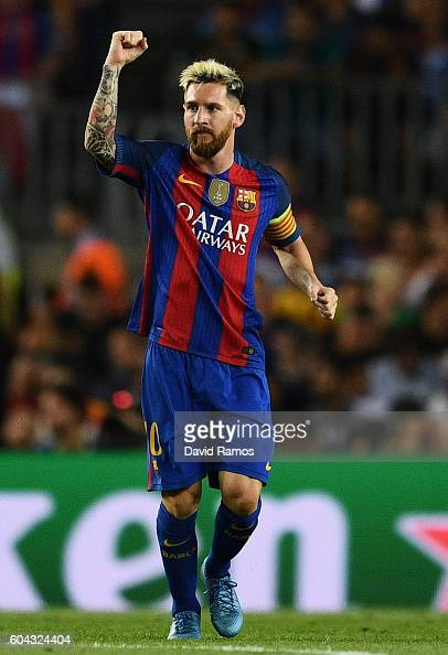 Lionel Messi of Barcelona celebrates scoring his sides first goal ...