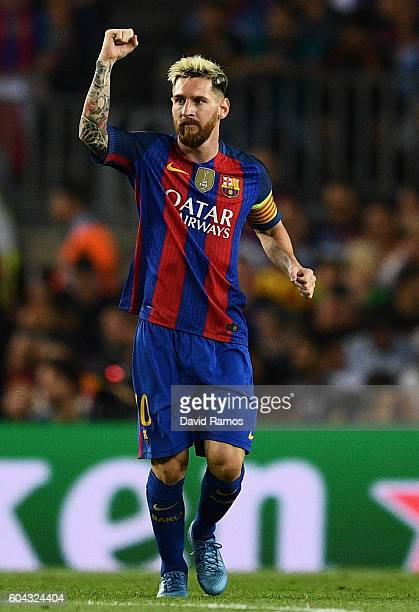 Lionel Messi of Barcelona celebrates scoring his sides first goal during the UEFA Champions League Group C match between FC Barcelona and Celtic FC...