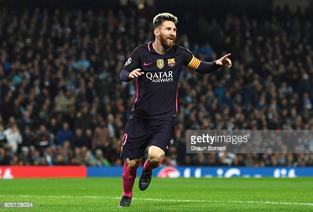 Lionel Messi of Barcelona celebrates scoring his sides first goal during the UEFA Champions League Group C match between Manchester City FC and FC...