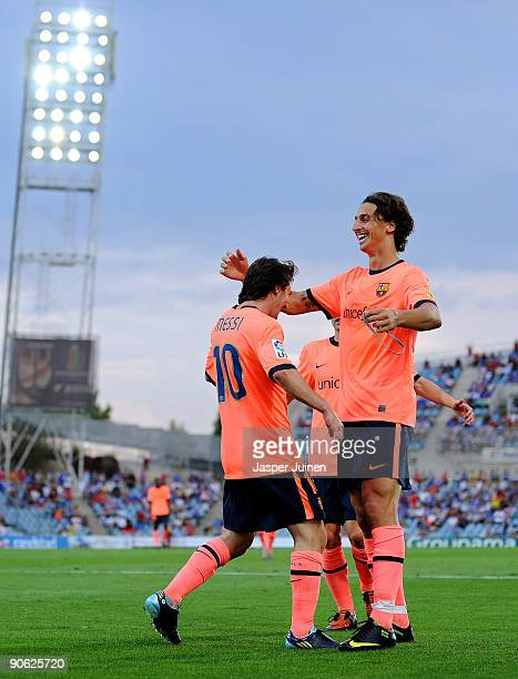Lionel Messi of Barcelona celebrates scoring his side's second goal with his team mate Zlatan Ibrahimovic during the La Liga match between Getafe and...