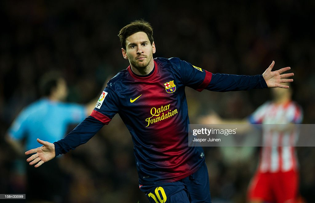 <a gi-track='captionPersonalityLinkClicked' href=/galleries/search?phrase=Lionel+Messi&family=editorial&specificpeople=453305 ng-click='$event.stopPropagation()'>Lionel Messi</a> of Barcelona celebrates scoring his sides third goal during the la Liga match between FC Barcelona and Club Atletico de Madrid at the Camp Nou stadium on December 16, 2012 in Barcelona, Spain.