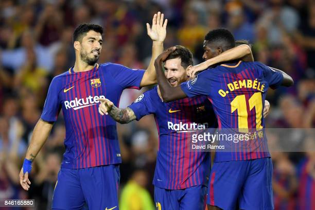 Lionel Messi of Barcelona celebrates scoring his sides third goal with Ousmane Dembele of Barcelona and Luis Suarez of Barcelona during the UEFA...