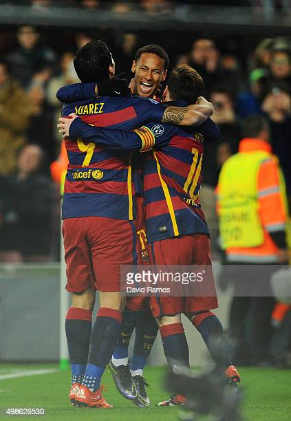 Lionel Messi of Barcelona celebrates scoring his teams fifth goal with Luis Suarez and Neymar of Barcelona during the UEFA Champions League Group E...
