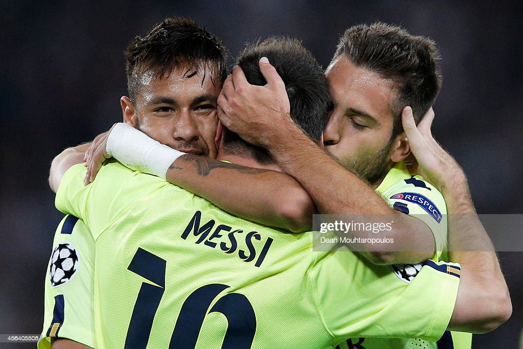 <a gi-track='captionPersonalityLinkClicked' href=/galleries/search?phrase=Lionel+Messi&family=editorial&specificpeople=453305 ng-click='$event.stopPropagation()'>Lionel Messi</a> of Barcelona celebrates scoring his teams first goal of the game with Neymar (L) and <a gi-track='captionPersonalityLinkClicked' href=/galleries/search?phrase=Jordi+Alba&family=editorial&specificpeople=5437949 ng-click='$event.stopPropagation()'>Jordi Alba</a> (R) during the Group F UEFA Champions League match between Paris Saint-Germain v FC Barcelona held at Parc des Princes on September 30, 2014 in Paris, France.