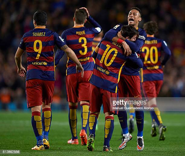 Lionel Messi of Barcelona celebrates scoring his team's first goal with his teammate Neymar JR during the La Liga match between FC Barcelona and...