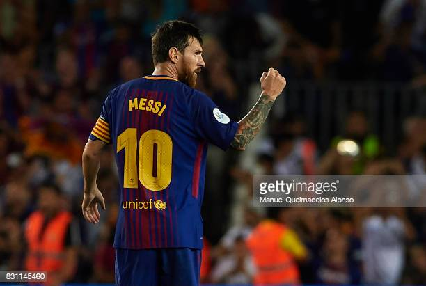 Lionel Messi of Barcelona celebrates scoring his team's first goal during the Supercopa de Espana Supercopa Final 1st Leg match between FC Barcelona...