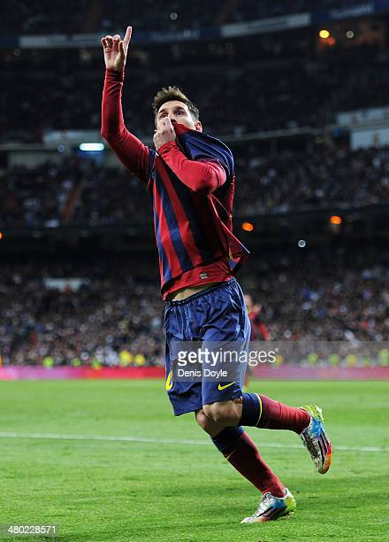 Lionel Messi of Barcelona celebrates scoring his team's fourth goal during the La Liga match between Real Madrid CF and FC Barcelona at the Bernabeu...
