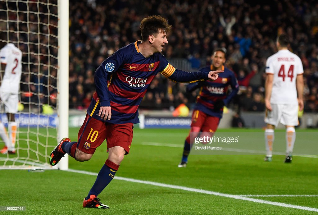 Lionel Messi of Barcelona celebrates scoring his teams second goal during the UEFA Champions League Group E match between FC Barcelona and AS Roma at...