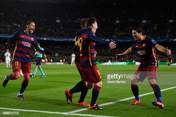 Lionel Messi of Barcelona celebrates scoring his teams second goal with Neymar and Luis Suarez during the UEFA Champions League Group E match between...