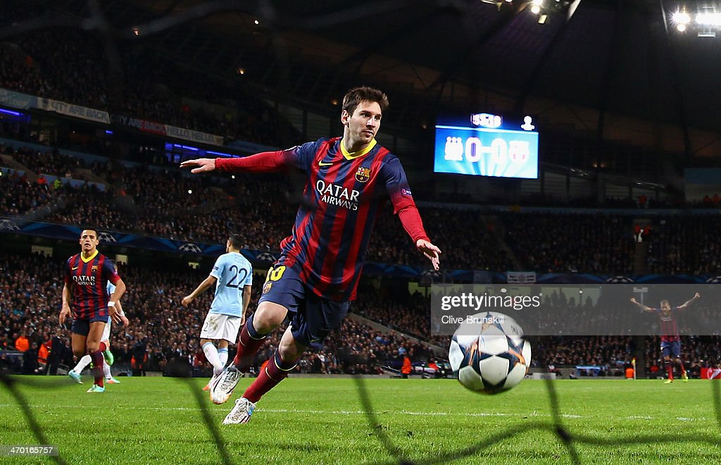 Lionel Messi of Barcelona celebrates scoring the opening goal from a penalty kick during the UEFA Champions League Round of 16 first leg match between Manchester City and Barcelona at the Etihad Stadium on February 18, 2014 in Manchester, England.