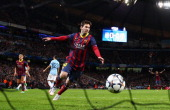 Lionel Messi of Barcelona celebrates scoring the opening goal from a penalty kick during the UEFA Champions League Round of 16 first leg match...