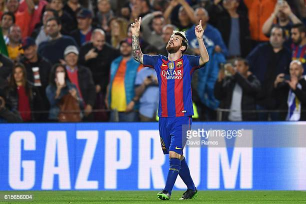 Lionel Messi of Barcelona celebrates scoring the opening goal of the game during the UEFA Champions League group C match between FC Barcelona and...