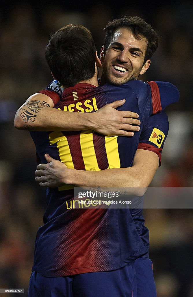 <a gi-track='captionPersonalityLinkClicked' href=/galleries/search?phrase=Lionel+Messi&family=editorial&specificpeople=453305 ng-click='$event.stopPropagation()'>Lionel Messi</a> of Barcelona celebrates scoring with his teammate Cesc Fabregas during the La Liga match between Valencia and Barcelona Estadio Mestalla on February 3, 2013 in Valencia, Spain.