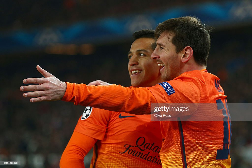 Lionel Messi (R) of Barcelona celebrates scoring with team-mate Alexis Sanchez during the UEFA Champions League Quarter Final match between Paris Saint-Germain and Barcelona FCB at Parc des Princes on April 2, 2013 in Paris, France.