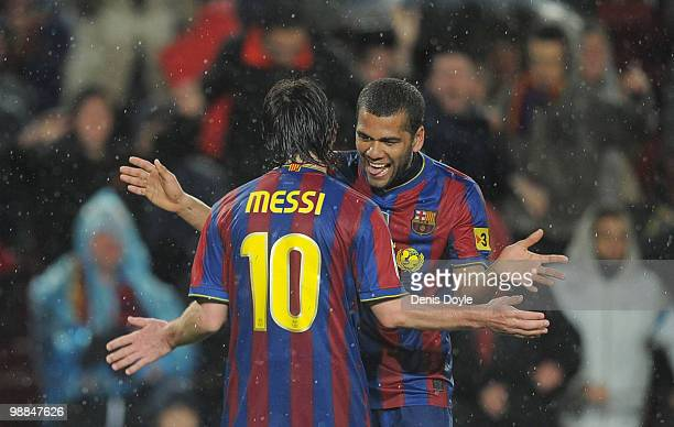 Lionel Messi of Barcelona celebrates with Daniel Alves after scoring Barcelon's fourth goal during the La Liga match between Barcelona and Tenerife...