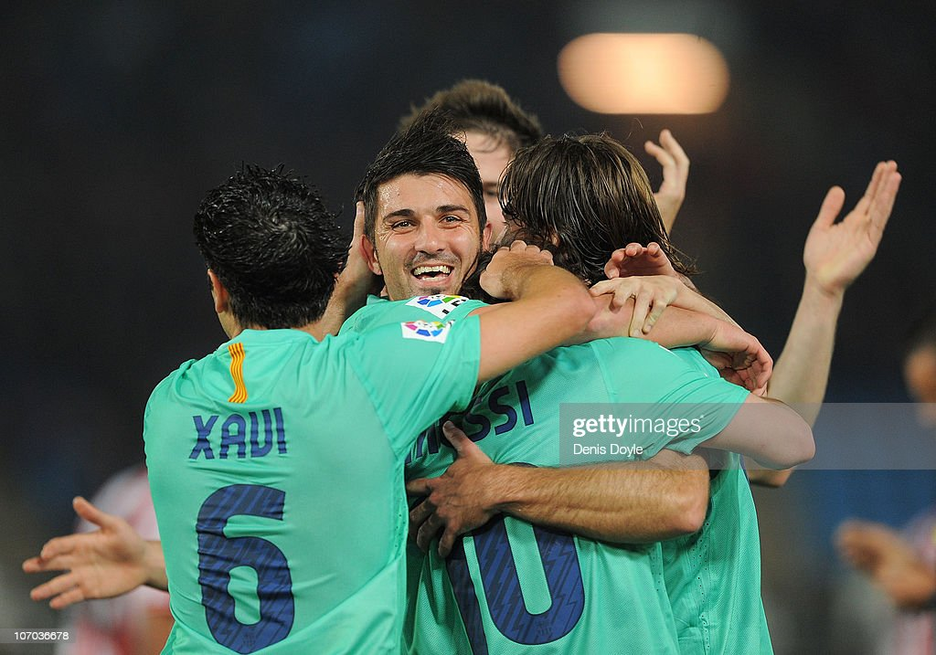 <a gi-track='captionPersonalityLinkClicked' href=/galleries/search?phrase=Lionel+Messi&family=editorial&specificpeople=453305 ng-click='$event.stopPropagation()'>Lionel Messi</a> (R) of Barcelona celebrates with <a gi-track='captionPersonalityLinkClicked' href=/galleries/search?phrase=David+Villa&family=editorial&specificpeople=467566 ng-click='$event.stopPropagation()'>David Villa</a> and <a gi-track='captionPersonalityLinkClicked' href=/galleries/search?phrase=Xavi+Hernandez+-+Soccer+Player&family=editorial&specificpeople=2834438 ng-click='$event.stopPropagation()'>Xavi Hernandez</a> after scoring Barcelona's opening goal during the La Liga match between UD Almeria and Barcelona at Estadio del Mediterraneo on November 20, 2010 in Almeria, Spain.