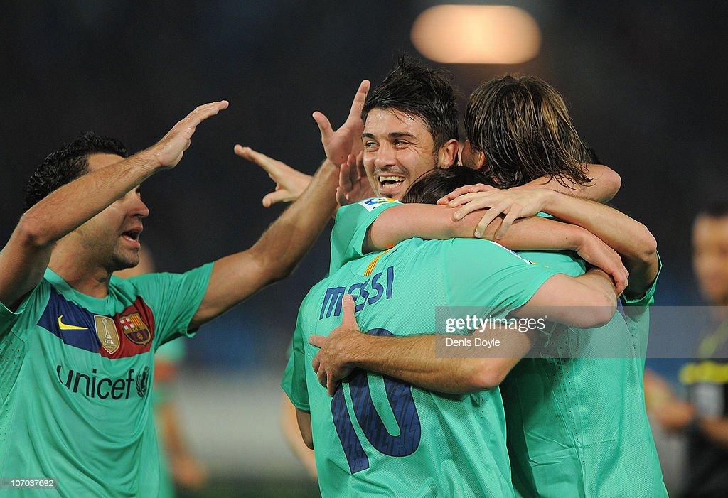 Lionel Messi of Barcelona celebrates with David Villa (C) and Xavi Hernandez (L) after scoring Barcelona's opening goal during the La Liga match between UD Almeria and Barcelona at Estadio del Mediterraneo on November 20, 2010 in Almeria, Spain.