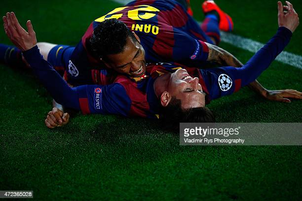 Lionel Messi of Barcelona celebrates with his team mate Daniel Alves after scoring his second goal during the first leg of UEFA Champions League...