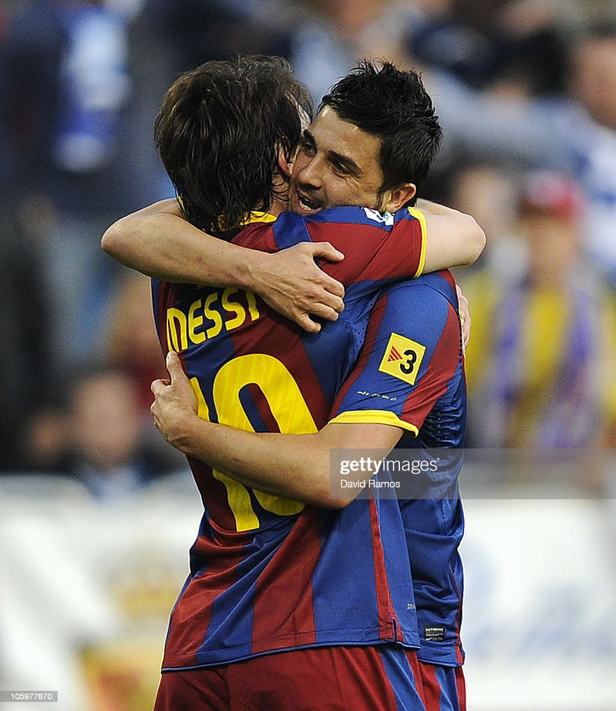 <a gi-track='captionPersonalityLinkClicked' href=/galleries/search?phrase=Lionel+Messi&family=editorial&specificpeople=453305 ng-click='$event.stopPropagation()'>Lionel Messi</a> of Barcelona (L) celebrates with his teammate <a gi-track='captionPersonalityLinkClicked' href=/galleries/search?phrase=David+Villa&family=editorial&specificpeople=467566 ng-click='$event.stopPropagation()'>David Villa</a> after scoring his side first goal during the La Liga match between Real Zaragoza and Barcelona at La Romareda on October 23, 2010 in Zaragoza, Spain.