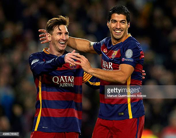 Lionel Messi of Barcelona celebrates with his teammate Luis Suarez during the UEFA Champions League Group E match between FC Barcelona and AS Roma at...