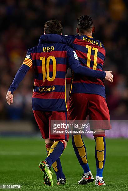Lionel Messi of Barcelona celebrates with his teammate Neymar JR during the La Liga match between FC Barcelona and Sevilla FC at Camp Nou on February...