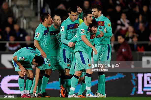 Lionel Messi of Barcelona celebrates with his teammates after scoring his first team's goal during the La Liga match between Mallorca and Barcelona...