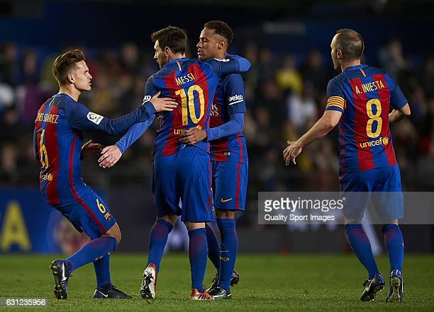 Lionel Messi of Barcelona celebrates with his teammates after scoring a goal during the La Liga match between Villarreal CF and FC Barcelona at...