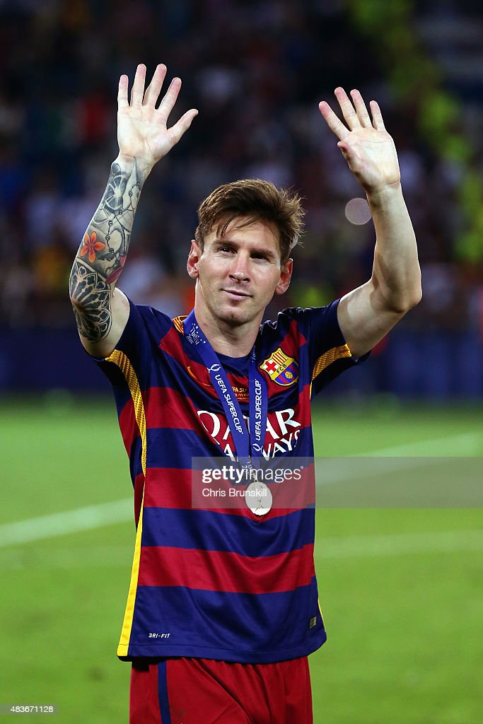 <a gi-track='captionPersonalityLinkClicked' href=/galleries/search?phrase=Lionel+Messi&family=editorial&specificpeople=453305 ng-click='$event.stopPropagation()'>Lionel Messi</a> of Barcelona celebrates with his winners medal after victory in the UEFA Super Cup between Barcelona and Sevilla FC at Dinamo Arena on August 11, 2015 in Tbilisi, Georgia.